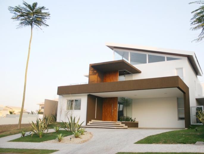 Fachadas de casas modernas com telhado embutido e for Casas modernas lindas