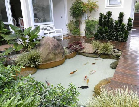 Como fazer um lago artificial no jardim decorando casas for Como criar carpas en estanques