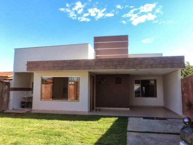 Garagem com telhado embutido decorando casas for Modelo de fachadas de viviendas