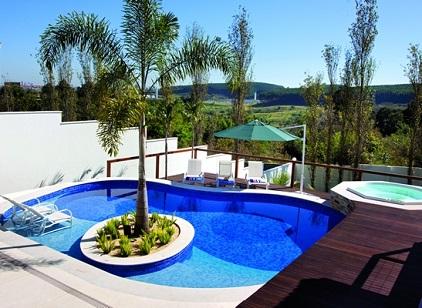 Piscina residencial com ilha decorando casas for Piscina residencial